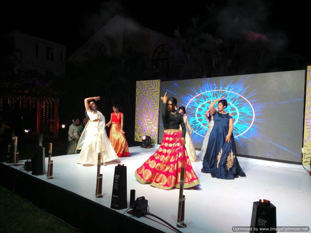 Dance performances including bride and groom at Sangeet Ceremony at The Royal Palms Farm House Injambakkam